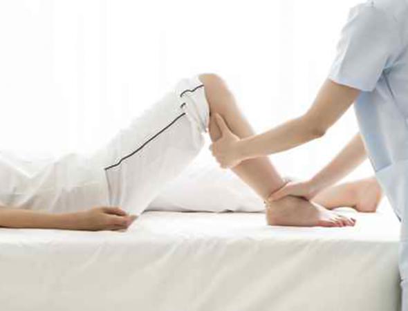 Women receiving sports massage